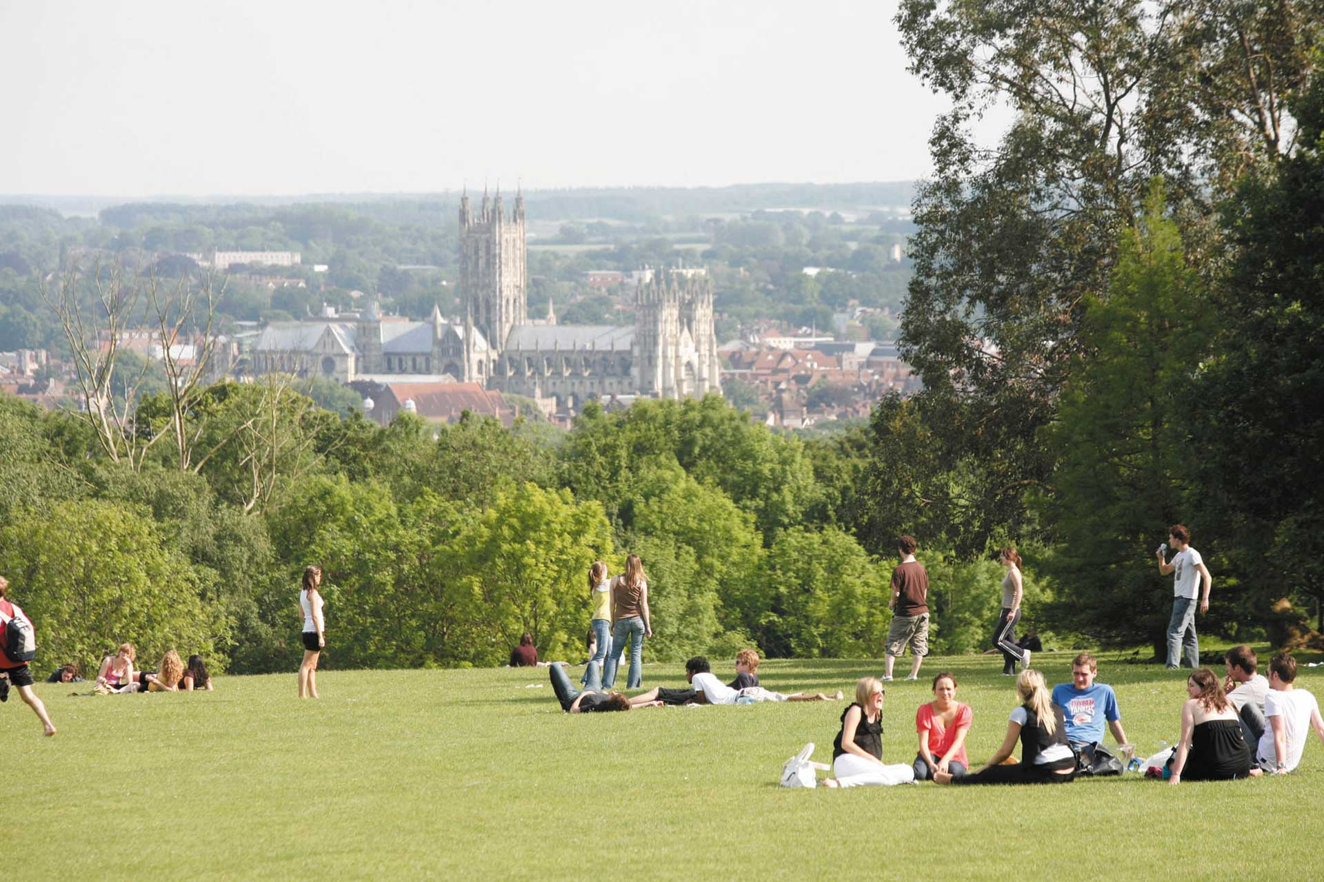 Students looking at the view of the Canterbury Cathedral from the campus parklands