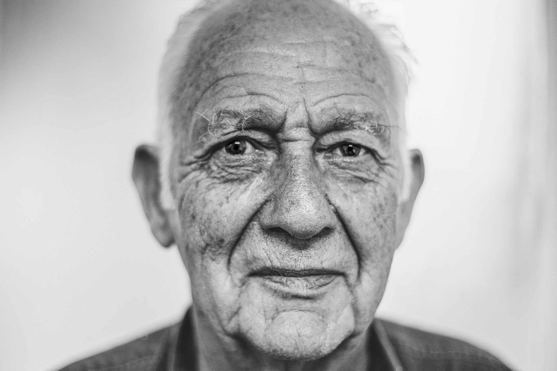 Black and white portrait of an elderly man