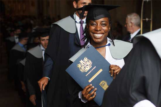 Student holding her certificate at a graduation ceremony