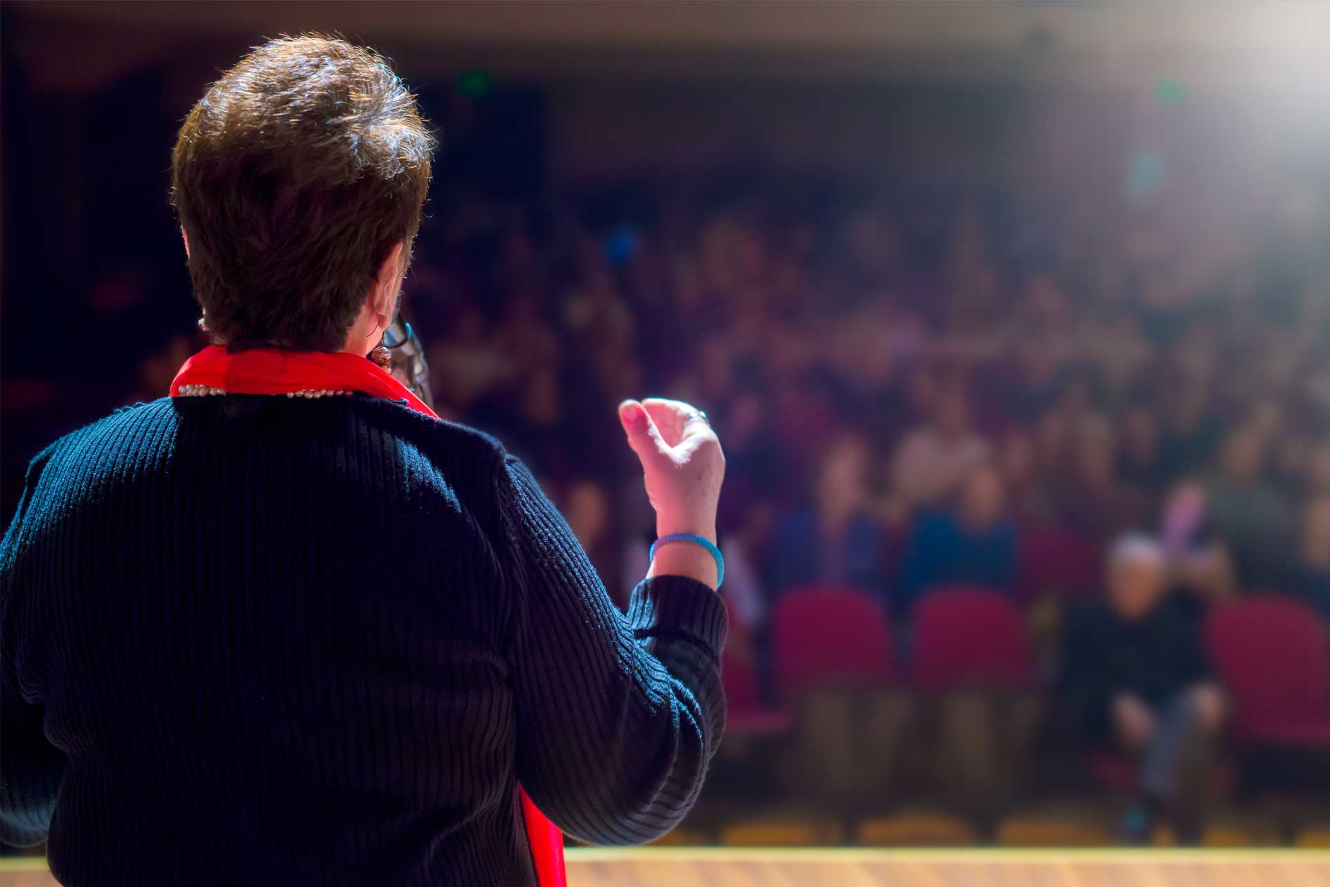 View of a person giving a presentation at a conference