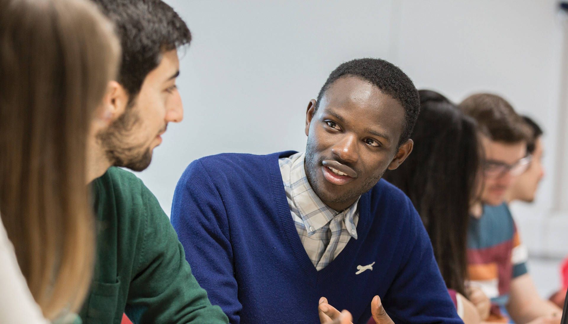 A student having a discussion with a colleague