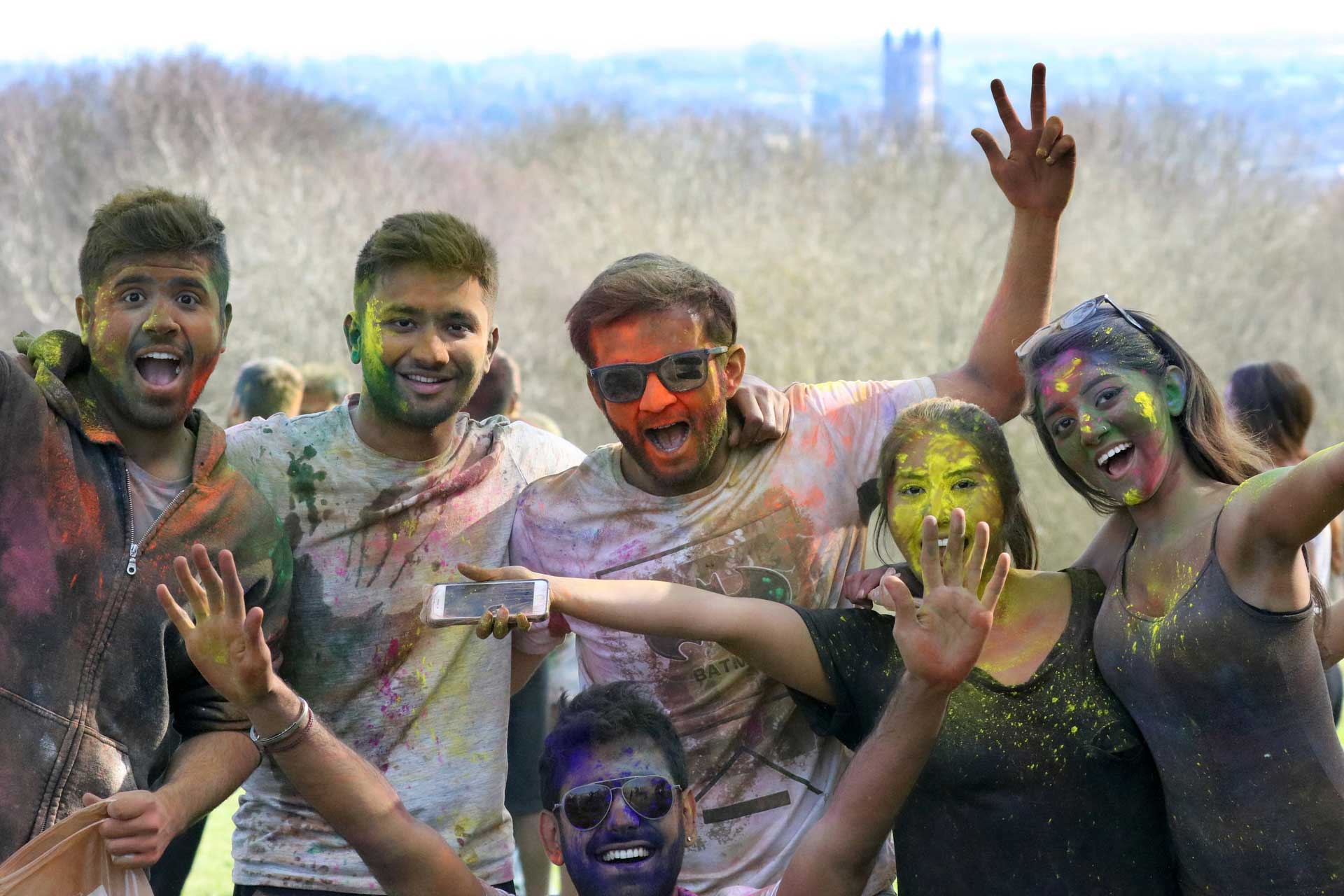 A group of students covered in colourful dust during the Holi Festival 2017