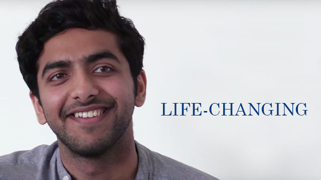 portrait of a young man smiling and looking slightly off-camera. The word 'life-changing' is superimposed on the image.